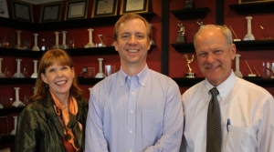 Jay Graves, center, with MP&F Public Relations partners Katy Varney and David Fox.